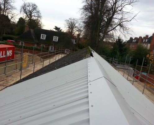 Roof over existing asbestos cement roof
