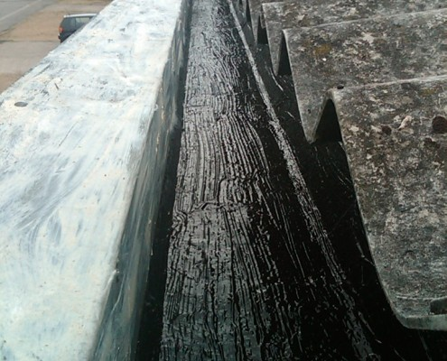 Gutter re-lined using liquid rubber