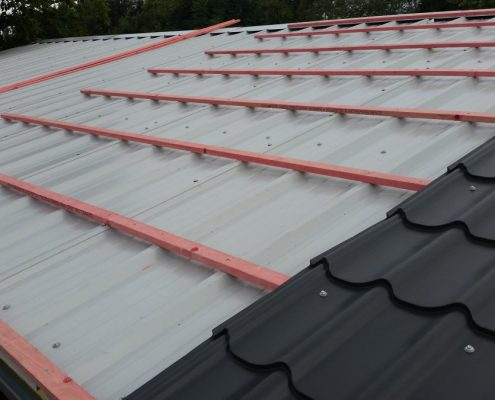 Roof battens installed over roof panels