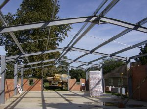 Steel framed kit form building
